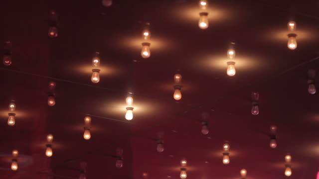 flashing lights on the ceiling at the movies - biosalong bildbanksvideor och videomaterial från bakom kulisserna