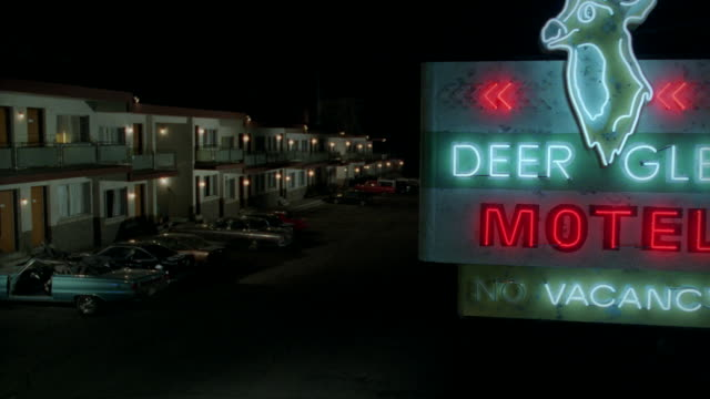 a flashing neon sign advertises a vacancy at the deer glen motel. - lobby stock videos & royalty-free footage