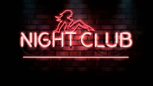 vidéos et rushes de clignotant neon sign boucle infinie - boite de nuit - discothèque