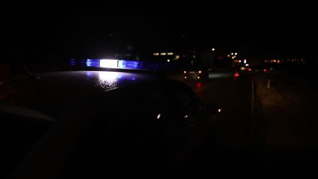 flashing police car lights in night time - emergency light stock videos & royalty-free footage