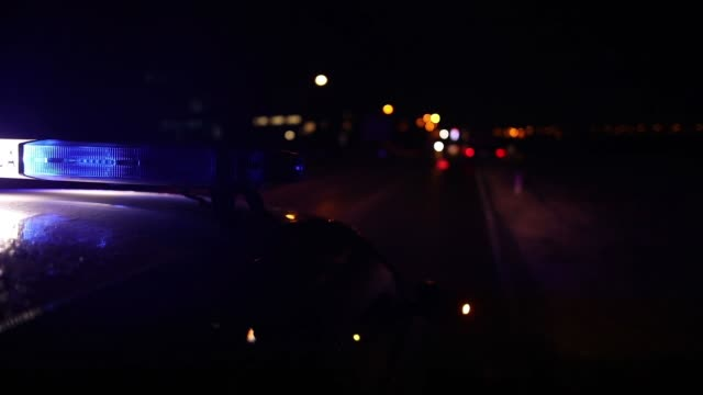 flashing police car lights in night time - police vehicle lighting stock videos & royalty-free footage