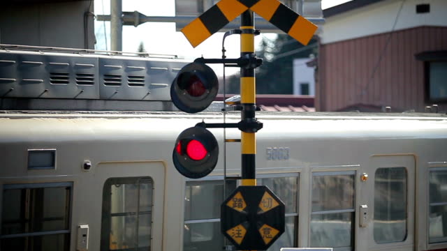 flashing railroad signal with train passing - level crossing stock videos & royalty-free footage
