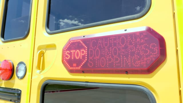 flashing stop sign on school bus - stop sign stock videos & royalty-free footage