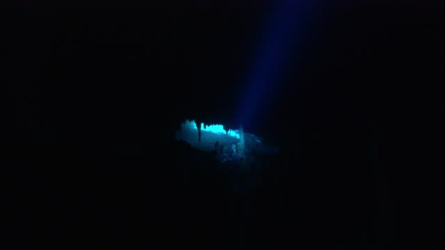 a flashlight beam shines through a cenote cave, yucatan, mexico. available in hd. - electric torch stock videos & royalty-free footage