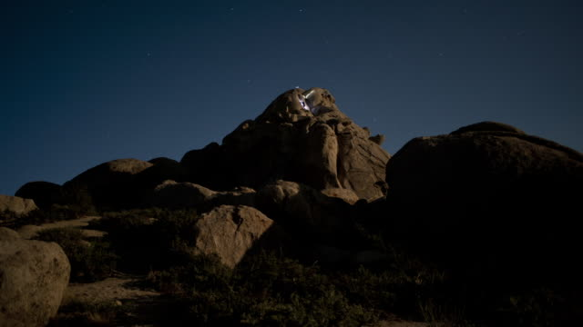 flashlight beams play across rock formations in the buttermilk range of the eastern sierra mountains. - rock formation stock videos & royalty-free footage