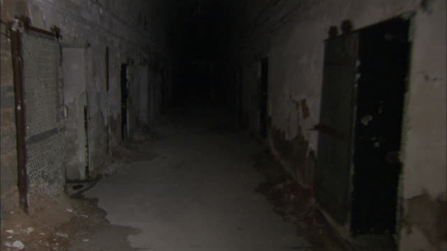 a flashlight illuminates a disused prison wing at the eastern state penitentiary. available in hd - eastern state penitentiary stock videos & royalty-free footage