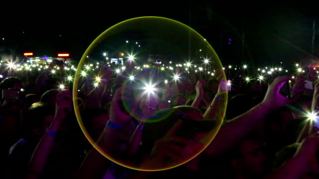 flashlights of smartphone viewers at a rock concert - electric torch stock videos & royalty-free footage