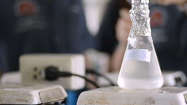 flask in engineer laboratory - laboratory flask stock videos & royalty-free footage