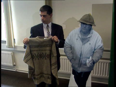 staffordshire int various of police officer holding up woolly jumper beside cardboard cut out - flat cap stock videos & royalty-free footage