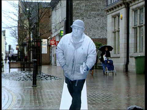 flat cap robber in court originally from [lib ] la ms direction signposts in street tilt down to cardboard cutout gv wanted sign det sgt dave chidgey... - flat cap stock videos & royalty-free footage