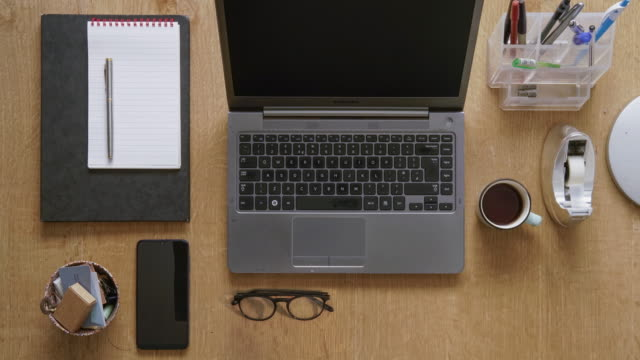 flat lay hot desking - stationary stock videos & royalty-free footage