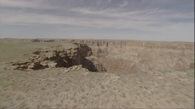A flat mesa ends in a sheer drop off into the Grand Canyon. Available in HD.