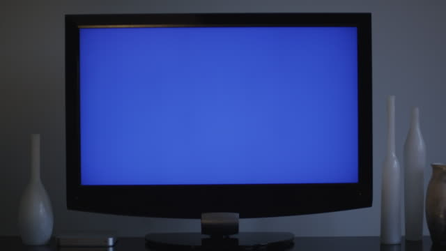 flat screen television, blue screen for compositing, sets on a table decorated with urban vases. - 2009 stock videos & royalty-free footage