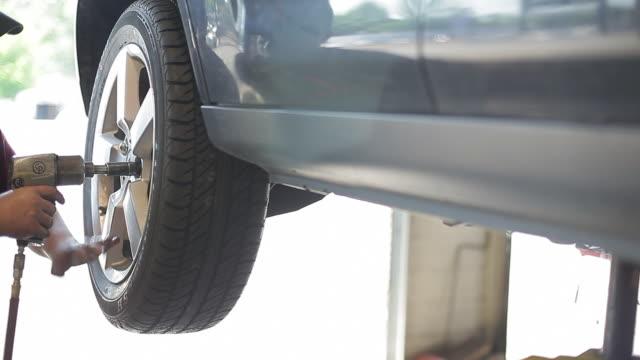 Flat Tire Repair and Car Maintenance at Garage
