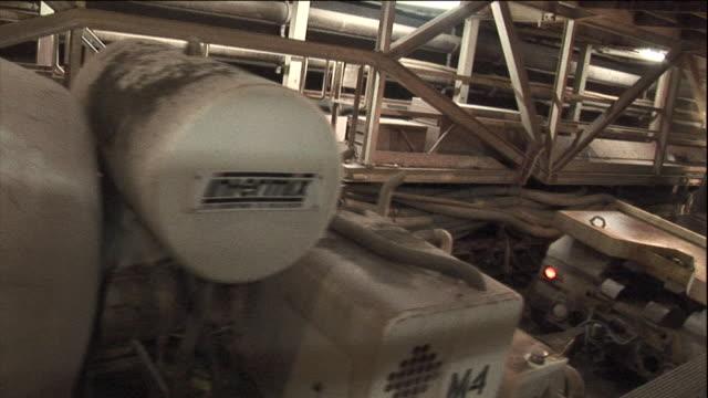 a flatbed trailer hauls a cement mixer through the niagara tunnel construction site. - cement mixer stock videos & royalty-free footage
