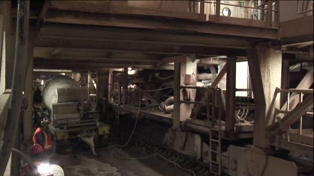 a flatbed trailer hauls a cement mixer through the niagara tunnel. - cement mixer stock videos & royalty-free footage