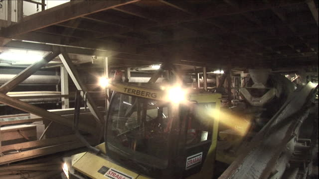 a flatbed trailer pulls a cement mixer through the niagara tunnel. - cement mixer stock videos & royalty-free footage
