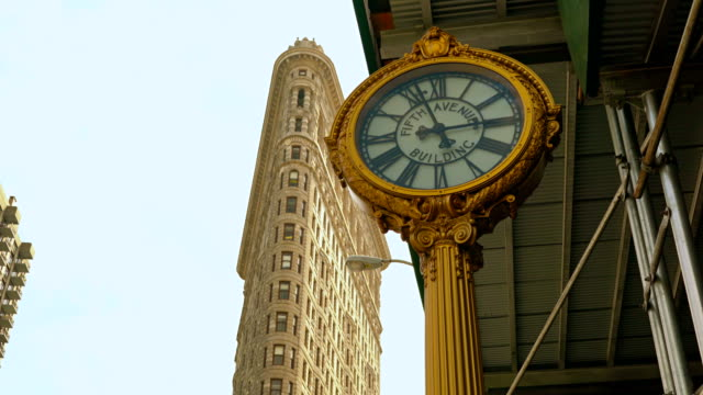 flatiron building and clock, manhattan, new york - flatiron building manhattan stock videos and b-roll footage