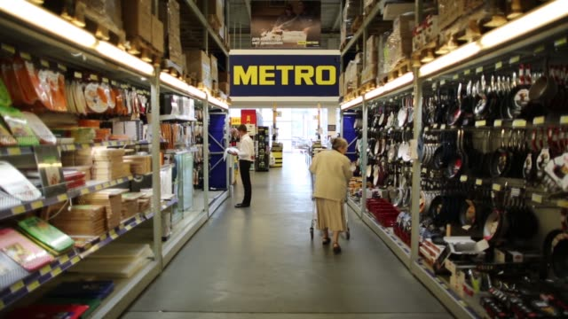 flatscreen television sets are displayed for sale in the electronics section of a metro cash carry store the russia unit of metro ag in moscow russia... - push cart stock videos and b-roll footage