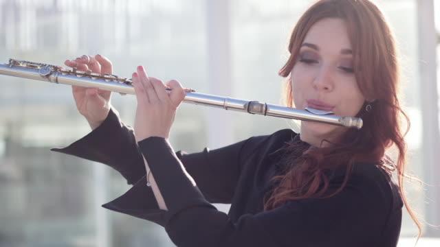 Flautist outdoors