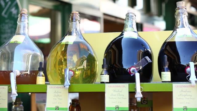 cu pan flavoured vinegars on sale on naschmarkt in vienna - vinegar stock videos & royalty-free footage