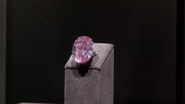 a flawless 5960 carat pink diamond known as the pink star goes under the hammer at a sotheby's in geneva wednesday with auctioneers hoping to fetch a... - sotheby's stock videos and b-roll footage