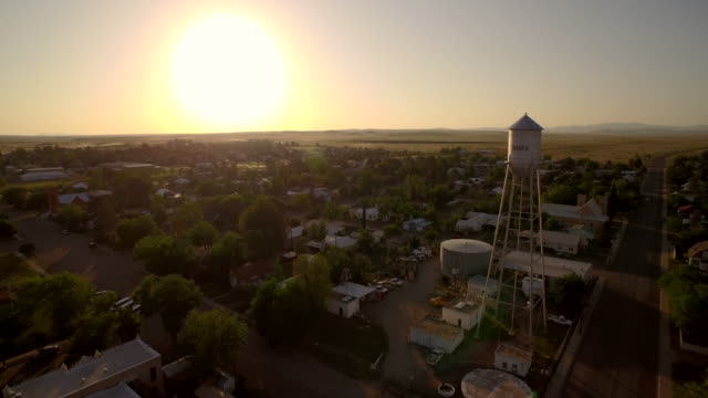 Flay back to reveal Marfa water tower in Texas