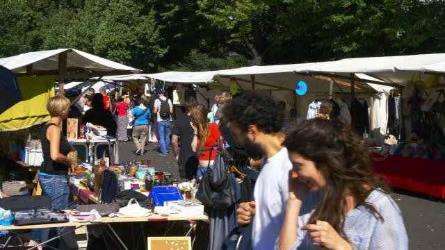 fleamarket on a sunny sunday in berlins trendy neighborhood neu-koeln - flea market stock videos & royalty-free footage