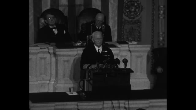 us fleet admiral chester nimitz stands at lectern during joint session of us congress senate president pro tempore kenneth mckellar and speaker of... - sam rayburn video stock e b–roll