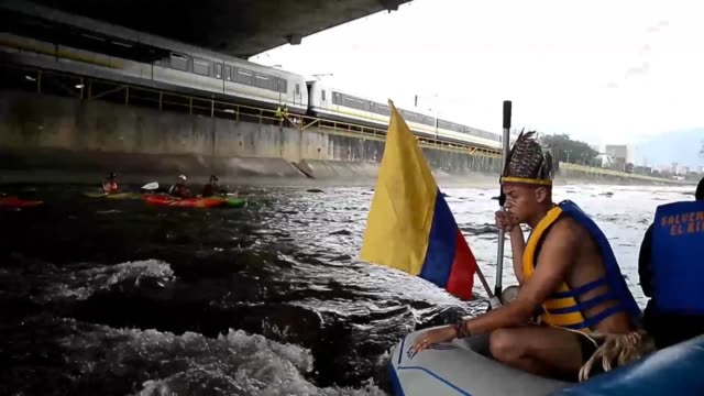 A fleet of 80 sailors and environmentalists aboard 35 watercraft takes a five kilometer journey on the Medellin River to draw attention to the...