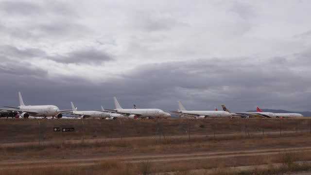 fleet of airplanes idle in times of covid-19 pandemic in teruel, spain, on tuesday, october 20, 2020. - land stock videos & royalty-free footage