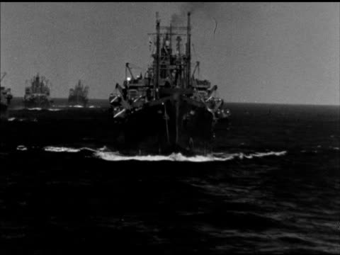 fleet of allied naval ships at sea various military vehicles including tanks trucks soldiers on deck of transport ships at sea gunner turning... - fleet of vehicles stock videos and b-roll footage