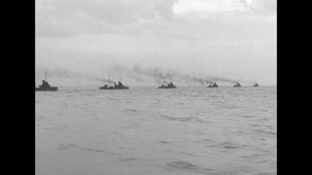 ws fleet of battleships anchored in baltic sea / fleet moving out to sea / battleships at anchor lighthouse in bg / ls battleships / destroyer flying... - baltic sea stock videos and b-roll footage