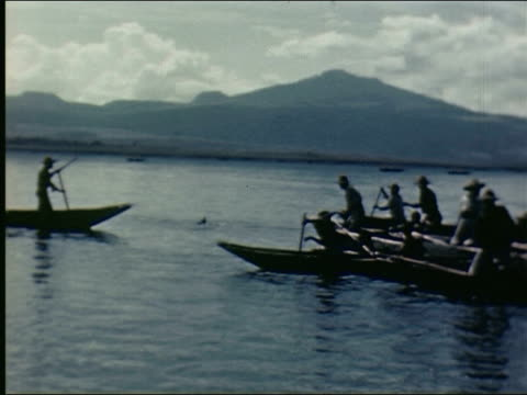 fleet of canoes with men standing and paddling at dawn on lake men stand in canoe and use harpoons to catch ducks / pov men paddling quckly / they... - harpoon stock videos and b-roll footage
