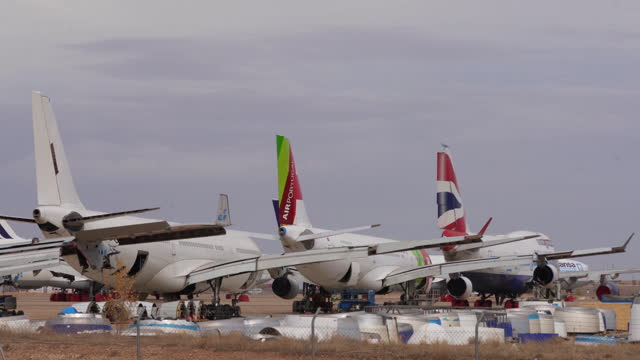 fleet of commercial airplanes parked at airport during covid-19 pandemic in teruel, spain, on tuesday, october 20, 2020. - land stock videos & royalty-free footage