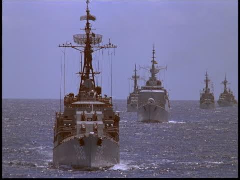 Fleet of Marine battleships sailing on ocean towards camera / Rio de Janeiro, Brazil