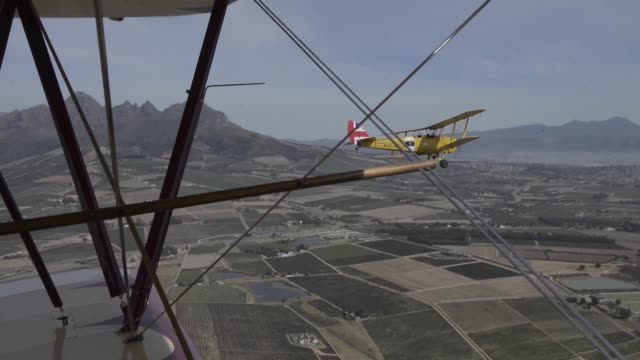 vídeos y material grabado en eventos de stock de a fleet of vintage planes arrive in stellenbosch in south africa at the end of an epic 13000 kilometre 36day long adventure flying from the greek... - stellenbosch