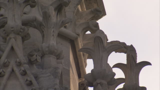 fleur de lis detailing decorates the facade of notre dame cathedral in paris. available in hd. - fleur de lys stock videos & royalty-free footage