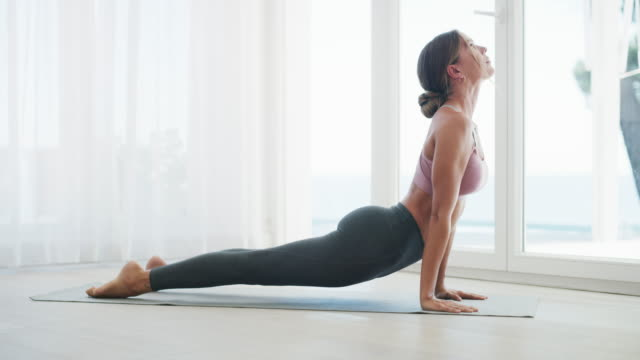 flexibility is crucial to fitness - yoga stock videos & royalty-free footage