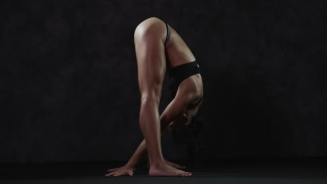 flexible asian woman bending over stretching body and legs - posture stock videos and b-roll footage