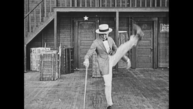 1919 a flexible vaudeville entertainer (jack coogan sr.) dances with a cane while man (fatty arbuckle) laughs - slapstick stock videos & royalty-free footage