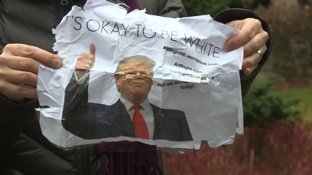 WXMI Fliers reading 'It's Okay To Be White' in several different formatssome of them contained pictures of President Trumpwere found posted on...
