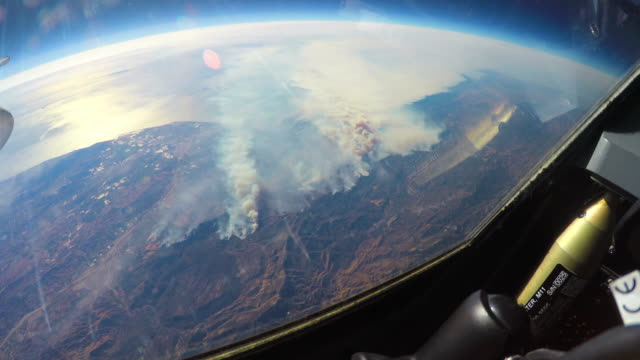 nasa flies the plane full of scientific equipment over the california fires to study the natural phenomenon and its impact on the environment... - atmosphere filter stock videos and b-roll footage