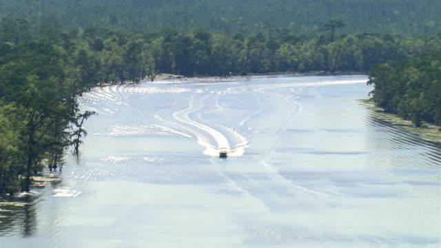flight above a boat on a louisiana bayou - artbeats stock videos & royalty-free footage
