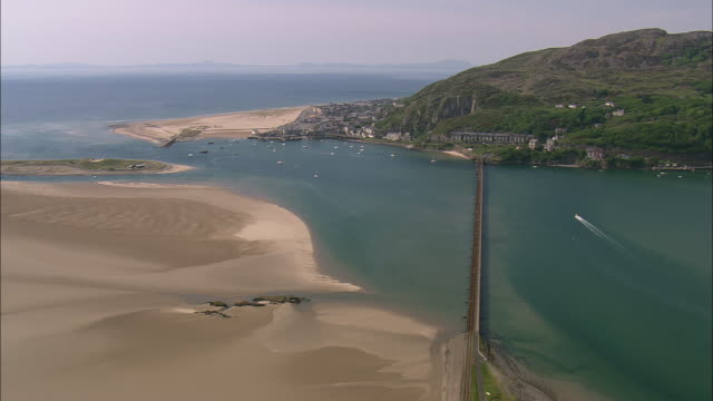 flight across barmouth railway bridge - wales stock videos & royalty-free footage