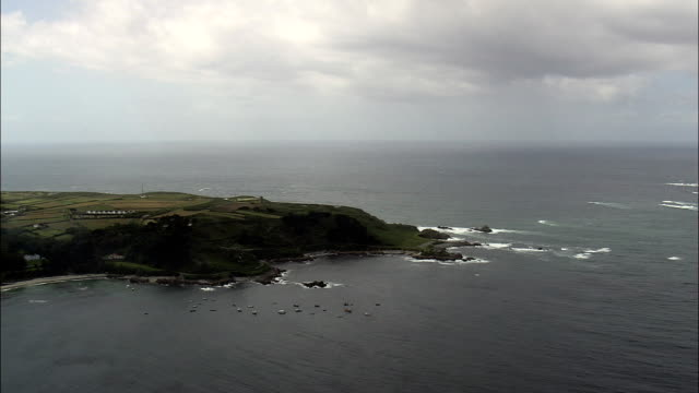 flight across guernsey's south coast  - aerial view - helicopter filming,  aerial video,  cineflex,  establishing shot,  guernsey - guernsey stock videos and b-roll footage