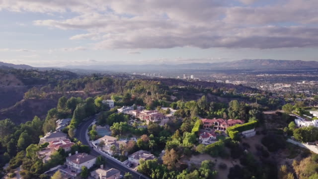 flight across mulholland drive between beverly hills and sherman oaks - beverly hills california stock videos & royalty-free footage