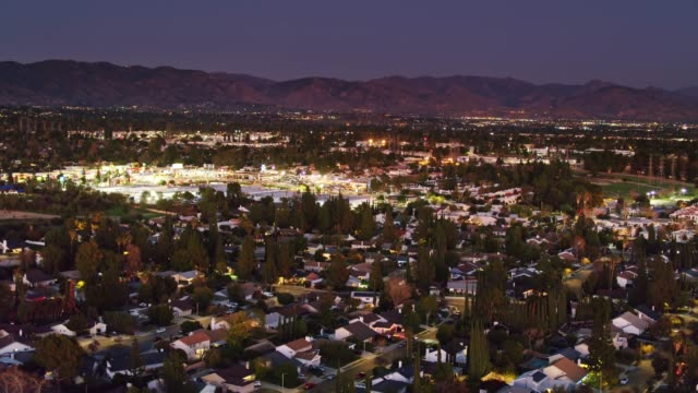 flight across northridge at nightfall - aerial establisher - northridge stock videos & royalty-free footage