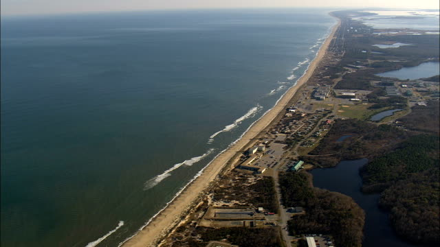 flight across the border from virginia  - aerial view - north carolina,  currituck county,  united states - north carolina beach stock videos & royalty-free footage