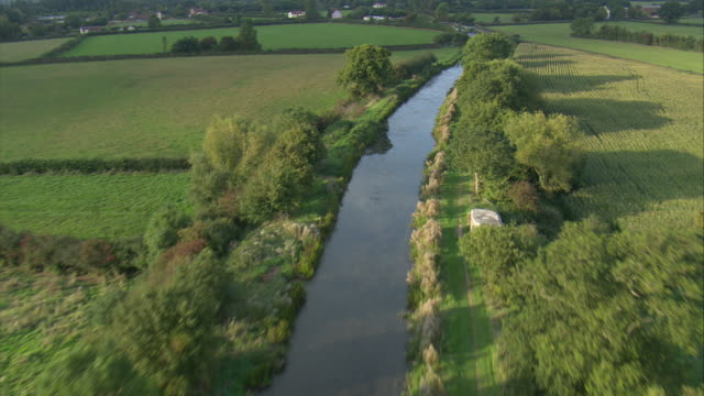 flight along bridgewater and taunton canal - somerset england stock videos & royalty-free footage